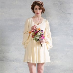 Bell sleeve cream colored peasant dress